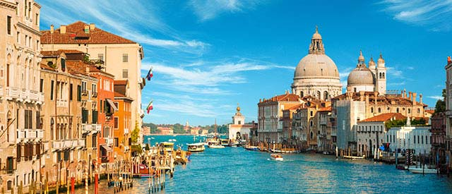 Italian city with blue water and sky