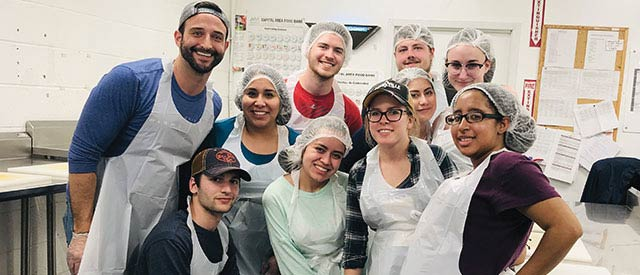 Carrol alumni and students at a food kitchen in Washington, D.C.