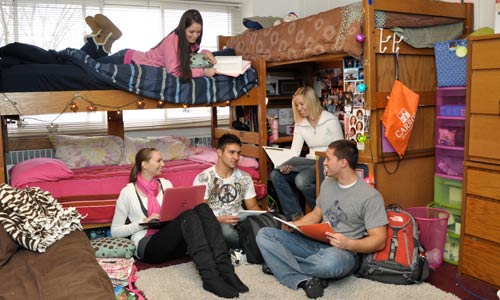 Photo of students studying in dorm room