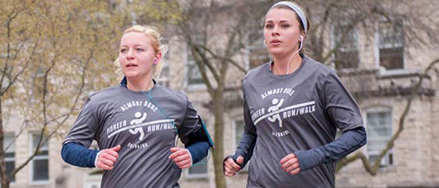 Participants running a 5K on the Carroll University campus