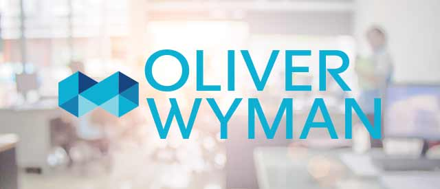 blurry business background with Oliver Wyman logo