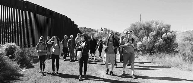 students walking along a border